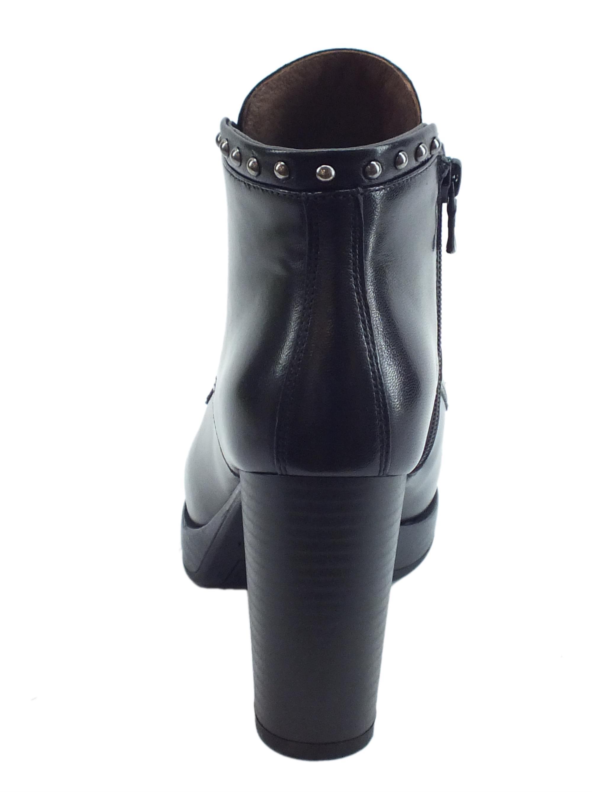 3e040bd704 Tronchetti NeroGiardini in pelle nera con lacci e lampo laterale e tacco  alto