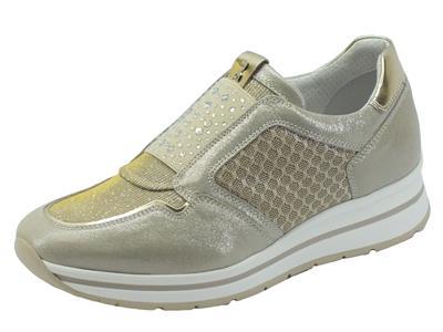 Articolo Sneakers NeroGiardini per donna in pelle beige effetti oro